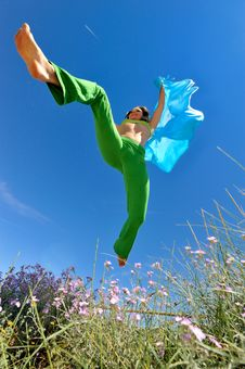 Girl With Blue Silk Scarf Jumping Royalty Free Stock Photos