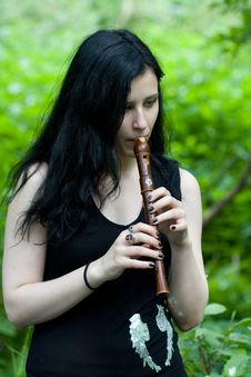 Free Woman With An Old Flute Stock Photo - 5513400