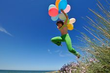 Free Girl With Balloons Jumping Royalty Free Stock Photos - 5513578