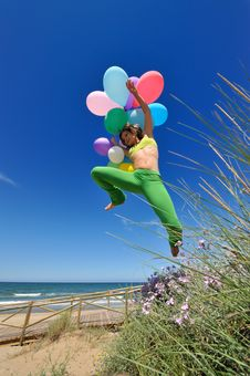 Free Girl With Colorful Balloons Jumping Royalty Free Stock Image - 5514516
