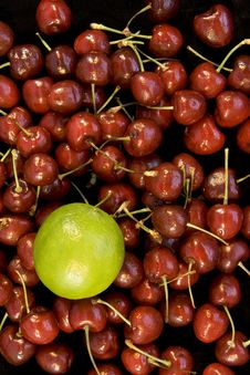 Free Multi Cherries With Single Lime Royalty Free Stock Photos - 5515388