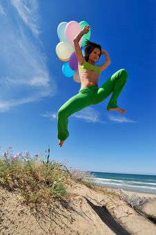 Free Girl With Colorful Balloons Jumping Royalty Free Stock Image - 5516956
