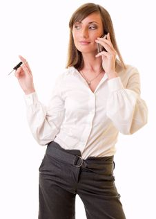 Businesswoman With Keys And Mobile Phone Stock Photography