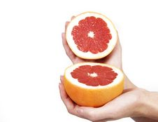 Free Closeup Of Hands With Grapefruit On White Stock Photo - 5517790