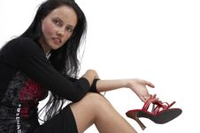 Beautiful Brunette Woman With Red Shoes Royalty Free Stock Photo