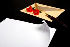Envelope With Flowers And Pen Stock Images