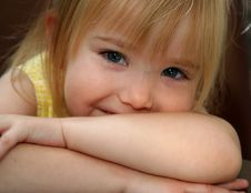 Free Little Girl Smiling Over Crossed Arms Stock Photos - 5522833