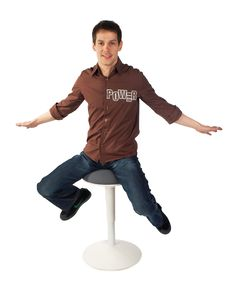 Young Man Sits On Stool. Royalty Free Stock Photo