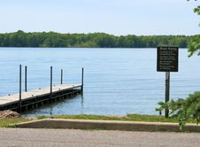 Free Boat Dock And Sign At The Lake Stock Image - 5525051
