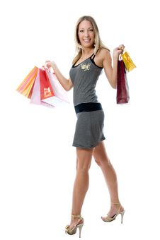 Free Happy Young Woman Holding Bags Stock Image - 5525891