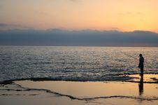 Fisherman At Sunset Royalty Free Stock Image