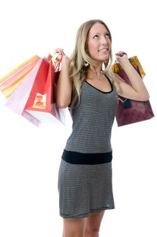 Free Happy Young Woman Holding Bags Stock Image - 5525921