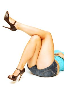 Nice Legs Laying On The Floor. Royalty Free Stock Images