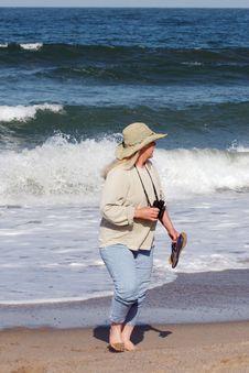 Free Woman Walking On Beach Stock Photography - 5526702