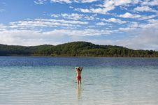 Free Young Girl Standing In The Tranquil Lake Stock Photos - 5528203