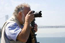 Free Photographer Focusing His Camera Stock Photography - 5528732