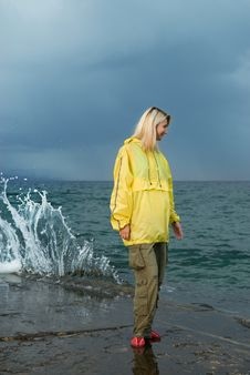Free Young Woman In Yellow Raincoat Royalty Free Stock Photography - 5529787