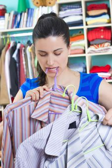Free Housewife Putting Clothes On Available Space Stock Photos - 5530773