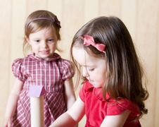 Portrait Of Two Little Girls Building Toy Tower Royalty Free Stock Photo