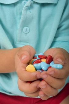 Candies In Child Hands Stock Image