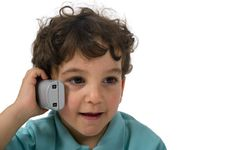 Young Boy Talking On The Phone Stock Image