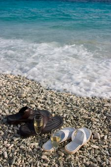Free Sandals By The Shore Royalty Free Stock Photo - 5532235