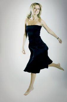 Free Jumping Woman With Black Dress Royalty Free Stock Photography - 5533147