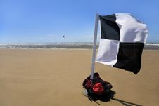 Free Beach Scene With Kitesurfing And Flag Royalty Free Stock Image - 5533416