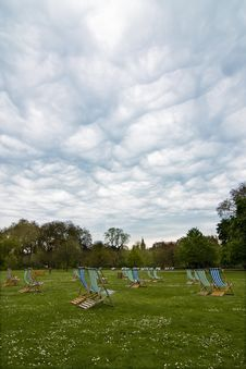 Free Empty Deck Chairs Under Dramatic Cloudscape Royalty Free Stock Photo - 5537505