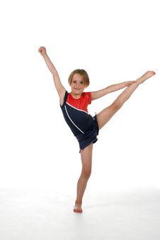 Young Girl Balancing On One Leg Stock Photo