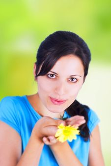 Free Woman And Yellow Flower Royalty Free Stock Image - 5541306