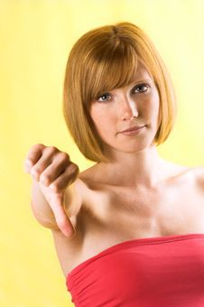 Free Beautiful Woman With Thumb Down Royalty Free Stock Image - 5542866