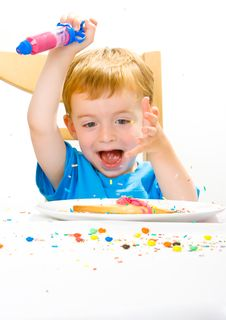 Free Boy Decorating Baked Biscuits Royalty Free Stock Image - 5542946