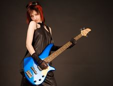 Free Rock Girl With Blue Bass Guitar Royalty Free Stock Photos - 5545098
