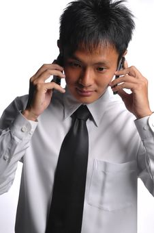 Free Asian Business Man Busy With Multiple Handphones Royalty Free Stock Photos - 5549978