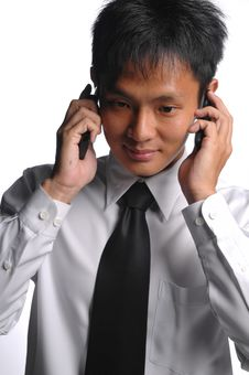 Free Asian Business Man Busy With Multiple Handphones Stock Photography - 5549982