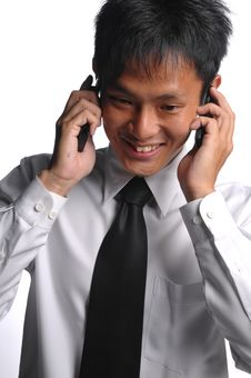 Free Asian Business Man Busy With Multiple Handphones Royalty Free Stock Photography - 5549987