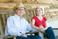 Free Cowboy And Cowgirl On A Porch - Horizontal Stock Images - 5555744