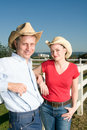 Free Cowboy And Cowgirl Against Fence - Vertical Royalty Free Stock Photos - 5556168