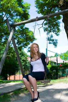 Free Portrait Of The Young Girl On A Swing Stock Image - 5551281
