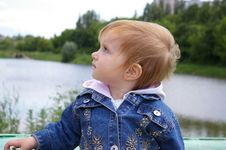 Girl Near A Beautiful Lake Stock Images