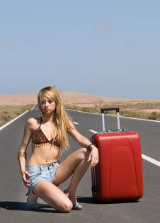 Free Woman On The Road With Her Suitcase Royalty Free Stock Image - 5552976