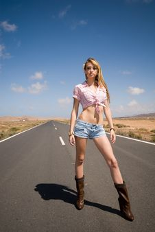 Beautiful Woman On The Road Waiting For A Car Stock Image