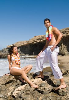 Free Man And Woman In The Beach With Flowers Necklace Stock Image - 5553211