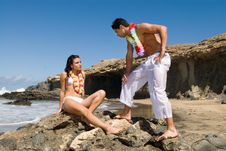 Free Man And Woman In The Seaside With Flower Necklace Stock Images - 5553214