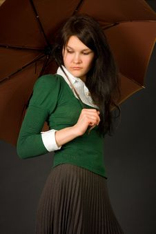 Free Girl In Green Sweater Holding Umbrella Stock Photography - 5554302