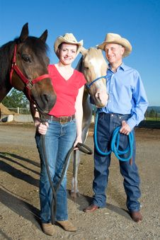 Free Man And Woman Stand With Horses - Vertical Royalty Free Stock Image - 5555516