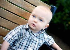Baby On Bench - Horizontal Royalty Free Stock Photography