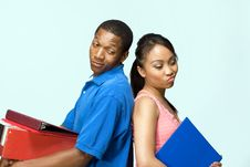 Free Students Standing Back To Back - Horizontal Royalty Free Stock Images - 5556189