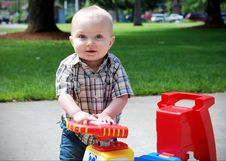 Free Baby Playing With Toy Truck - Horizontal Stock Images - 5556274